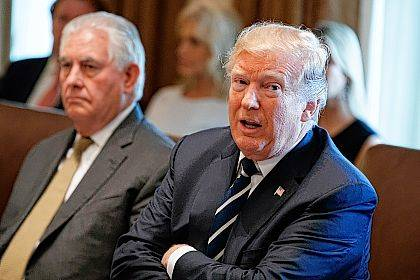 President Donald Trump speaks during a cabinet meeting at the White House, Monday, Oct. 16, 2017, in Washington, as Secretary of State Rex Tillerson listens. (AP Photo/Evan Vucci)