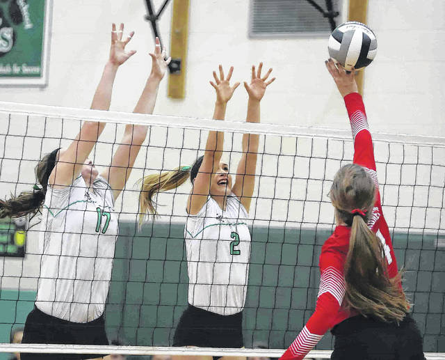 Wapakoneta's Sarah Pothast tries to get the ball past Celina's Maddy Luebke, left, and Kassidy Fark during Tuesday night's match in Celina. See more match photos at LimaScores.com.