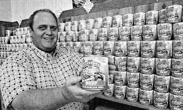 Dave Dorley poses with a product display for Keystone Brand Meats in 2000.