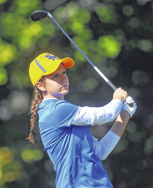 St Mary's Jill Schmitmeyer watches her tee shot on the 11th hole during Monday's district tournament at Sycamore Springs Golf Course in Findlay. The senior Roughrider finished third overall with a 76 and will travel to state for the third time.
