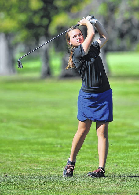 Lima Central Catholic's Mary Kelly Mulcahy watches her seconds shot on the ninth hole during Monday's district tournament at Sycamore Springs Golf Course in Findlay. The LCC linkster finished fourth overall with a 77.