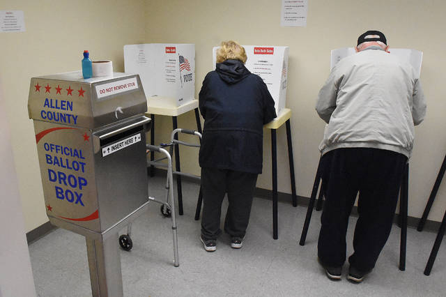 Joe and Carolyn Stoll, of Lima, cast early ballots at the Board of Elections in downtown Lima on Thursday afternoon.
