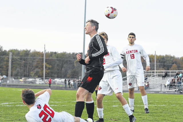 Elida's Seth Mahlmeister heads the ball during Thursday night's Division II district final against Kenton at the Elida Athletic Complex.