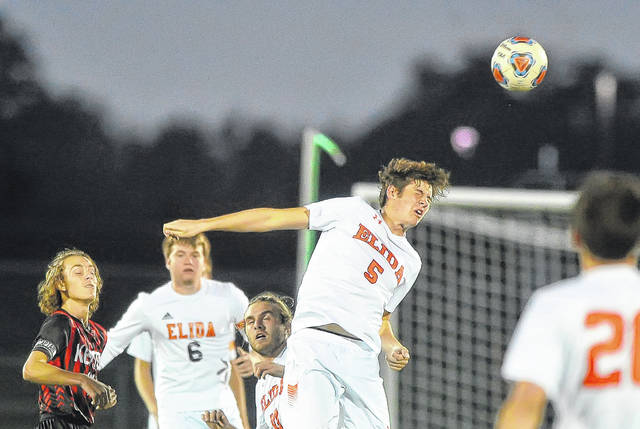 Elida's Max Parker heads the ball against Kenton during Thursday night's match at the Elida Sports Complex.