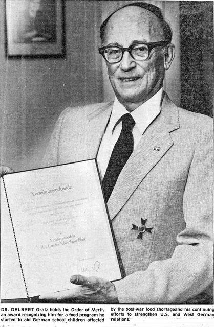 Delbert Gratz holds the Order of Merit, an award recognizing his efforts to help German children after the war. This photo dates from 1984.