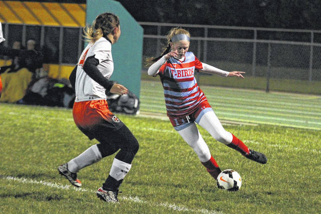Lima Central Catholic's Avery Rice is defended by Coldwater's Brianna Gillis during a Division III Wednesday night district semifinal against Continental at Ottoville.