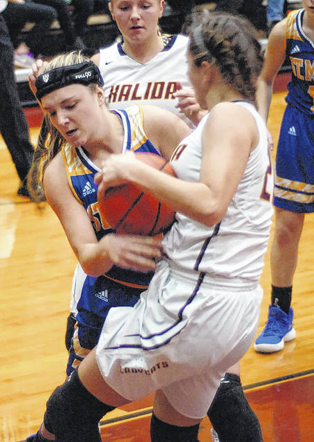 St. Marys' Makenna Mele fights for the rebound against Kalida's Kara Siefker during Tuesday night's game at Kalida. See more photos at LimaScores.com.
