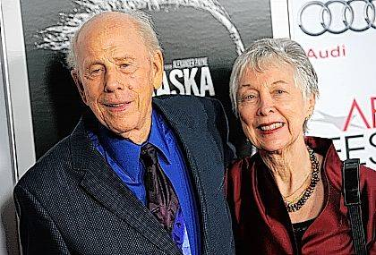"FILE - In this Nov. 11, 2013 file photo, Rance Howard, left, a cast member in ""Nebraska,"" and his wife Judy pose together at the 2013 AFI Fest premiere of the film at the TCL Chinese Theatre in Los Angeles. Director Ron Howard says his actor father Rance Howard has died at age 89. Howard announced his father's passing Saturday, Nov. 25, 2017, on Twitter. He appeared in several of Ron Howard's films, including ""Apollo 13,"" ''A Beautiful Mind,"" ''Splash,"" ''How the Grinch Stole Christmas,"" ''Parenthood"" and ""Grand Theft Auto,"" along with other film and television series credits. (Photo by Chris Pizzello/Invision/AP, File)"