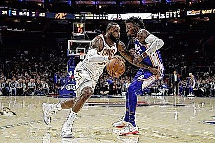 Cleveland Cavaliers' LeBron James, left, dribbles past Philadelphia 76ers' Robert Covington during the first half of an NBA basketball game Monday in Philadelphia.