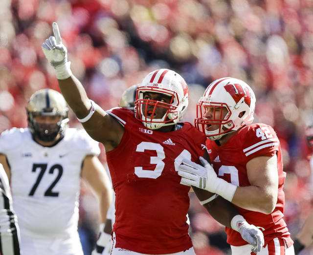 FILE - This Oct. 17, 2015, file photo shows Wisconsin's Chikwe Obasih (34) celebrating after sacking the Purdue quarterback during the second half of an NCAA college football game in Madison, Wis. No. 8 Ohio State's improved offensive line will have a big challenge slowing down No. 3 Wisconsin's powerful defensive front. The Buckeyes' line has stabilized after an inconsistent season in 2016. They'll face a Badgers front that anchors the best defense in the nation. Wisconsin is limiting opponents to an average of just 236.9 yards per game. (AP Photo/Andy Manis, File)