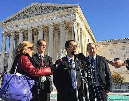 American Civil Liberties Union attorney Nathan Wessler speaks outside the Supreme Court on Wednesday in Washington, following arguments in a case about the government's ability to track Americans' movements through collection of their cellphone information. Chief Justice John Roberts and the court's four liberal justices indicated they could side with Wessler and extend the Constitution's protection against unreasonable searches to police collection of cellphone tower information that has become an important tool in the investigation of crimes.