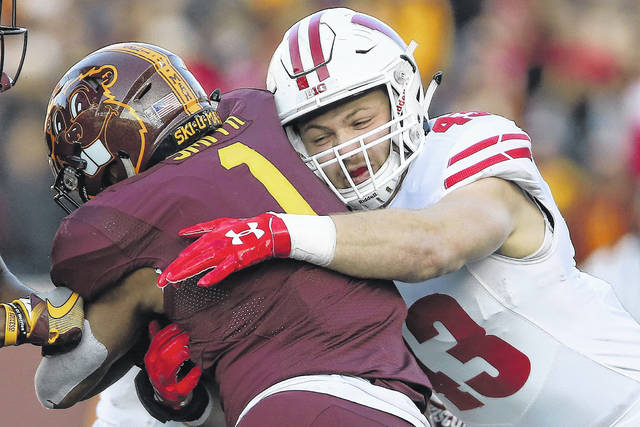 Wisconsin inside linebacker Ryan Connelly (43) tackles Minnesota running back Rodney Smith (1) during an NCAA college football game Saturday, Nov. 25, 2017, in Minneapolis. Wisconsin won 31-0. (AP Photo/Stacy Bengs)