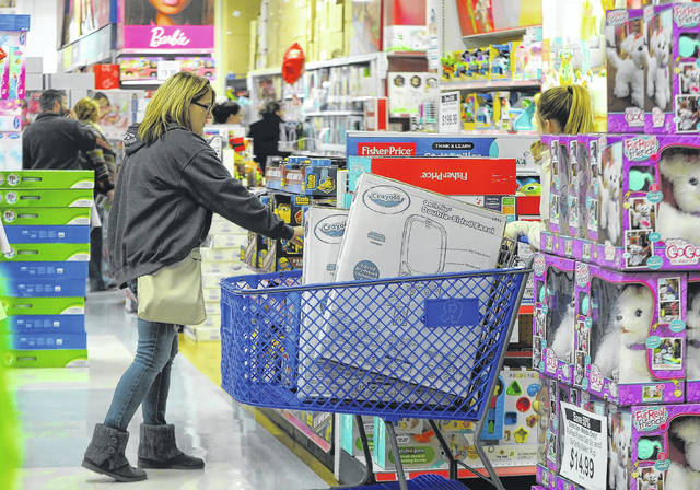 Customers shop at Toys R Us on Thanksgiving last year to get the best holiday shopping deals.