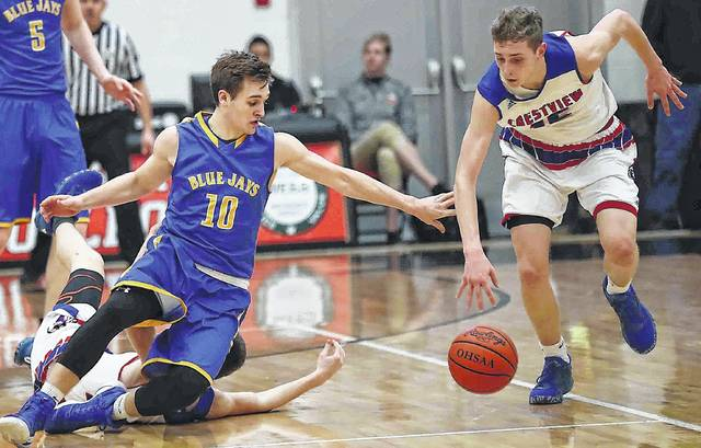 Crestview's Javin Etzler, right, battles Delphos St. John's Jared Wurst for the ball during the tournament last year. The Knights won 17 games last year and could be a team to watch this season, especially with Etzler getting offers from four NCAA Division I schools.