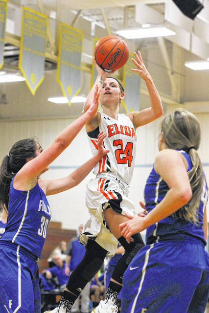 Elida's Shyah Wheeler goes up for a shot against Findlay during Friday night's 14th annual Kewpee Tip-Off Classic at Bath High School.