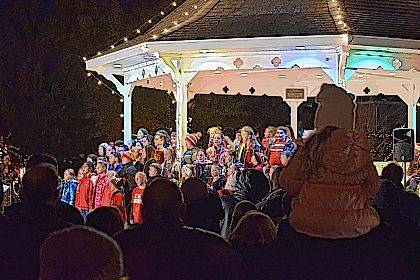 A Columbus Grove children's choir performs at Christmas in the Park on Sunday.