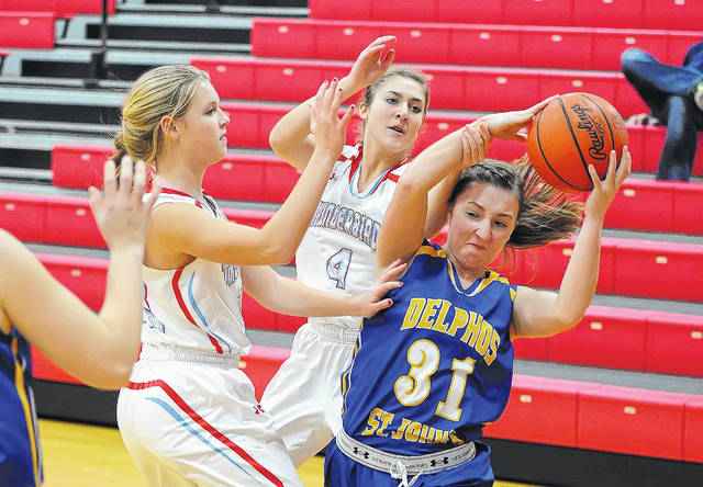 Lima Central Catholic's Jessica Wilker, left, and Hailey Koenig pressure Ellie Csukker of Delphos St. John's during Thursday night's game at Msgr. Edward C. Herr Gymnasium. See more game photos at LimaScores.com.