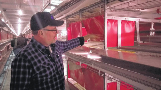 Dan Gossard, co-owner of Ruth Farms in Harrod, explains his farm's new Tecno Cage Free poultry system during an open house Thursday.