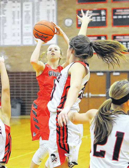 Columbus Grove's Rylee Sybert puts up a shot against Shawnee's Trinity Gearing during Tuesday night's game at Shawnee High School. See more game photos at LimaScores.com. Richard Parrish | The Lima News