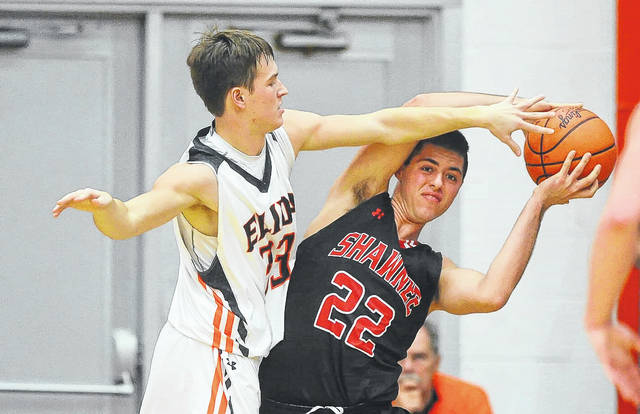 Shawnee's Brady Sweeny shields the ball away from Elida's Daniel Unruh during Saturday's Tip Off Classic at the Elida Fieldhouse.  Richard Parrish   The Lima News