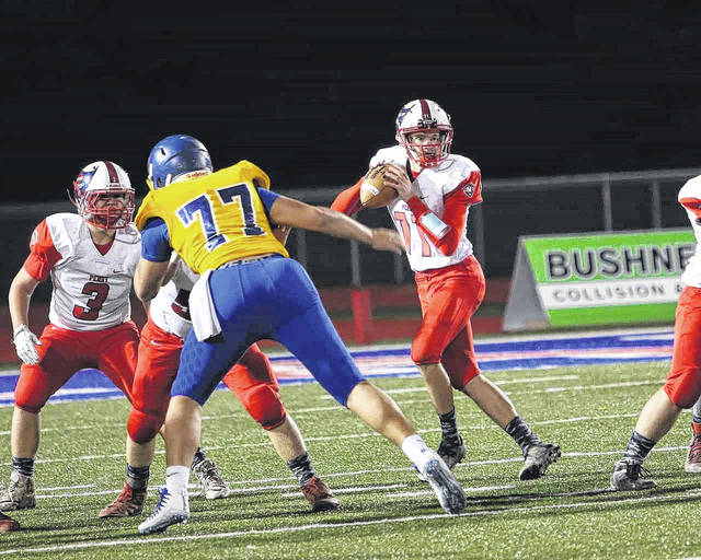 Perry's Louis Hoersten looks at his receiving options during Friday night's game against Lehman Catholic at Piqua.
