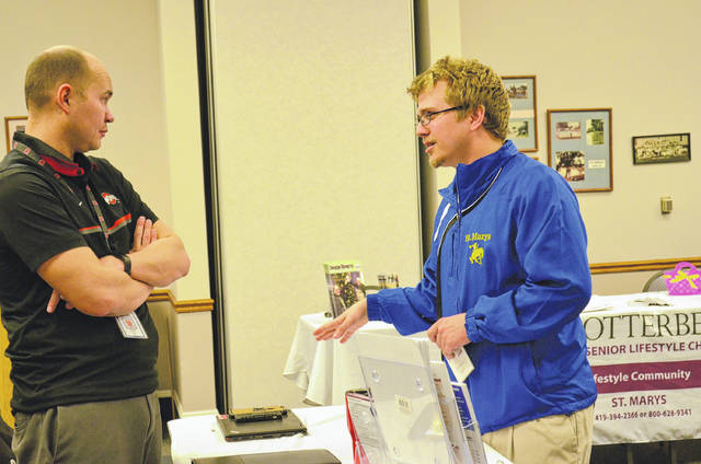 Zack Goodwin (right) a Project Search intern, speaks with Andrew Ellis, a vocational rehabilitation counselor with Opportunities for Ohioans with Disabilities who works with Project Search interns at Otterbein-St. Marys. Opportunities for Ohioans with Disabilities is one of the state and local organizations and agencies that partner, and help fund, Project Search.
