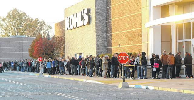 Black Friday customers line up outside Kohl's to get holiday shopping deals on Thanksgiving evening.