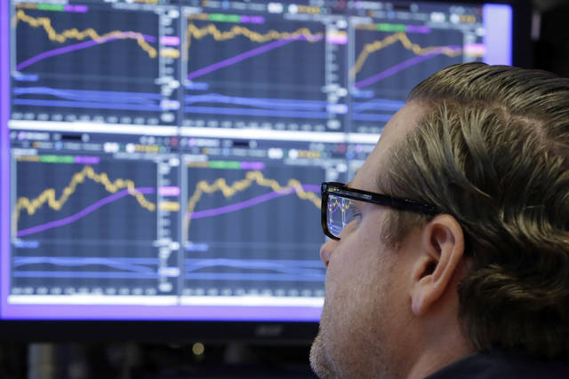 Specialist Gregg Maloney works at his post on the floor of the New York Stock Exchange, Monday, Dec. 4, 2017. Stocks rose Monday on expectations that lower taxes will help corporate profits pile up even higher. (AP Photo/Richard Drew)