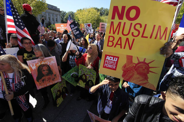 Protesters gather at a rally in Washington in October. The Supreme Court is allowing the Trump administration to fully enforce a ban on travel to the United States by residents of six mostly Muslim countries. The justices say in an order that the policy can take full effect even as legal challenges against it make their way through the courts.