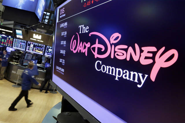The Walt Disney Co. logo appears on a screen above the floor of the New York Stock Exchange in August. Disney is buying a large part of the Murdoch family's 21st Century Fox in a $52.4 billion deal, announced Thursday, including film and television studios and cable and international TV businesses as it tries to meet competition from technology companies in the entertainment business.