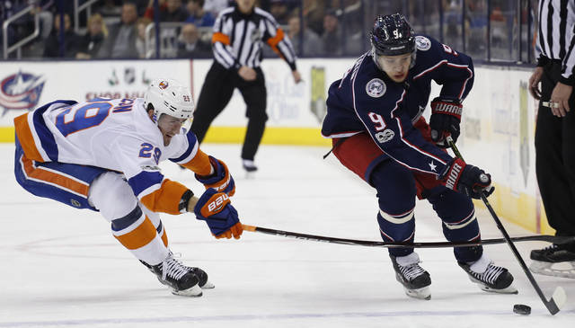 Columbus Blue Jackets' Artemi Panarin, right, of Russia, carries the puck across the blue line as New York Islanders' Brock Nelson defends during the second period of an NHL hockey game Thursday, Dec. 14, 2017, in Columbus, Ohio. (AP Photo/Jay LaPrete)