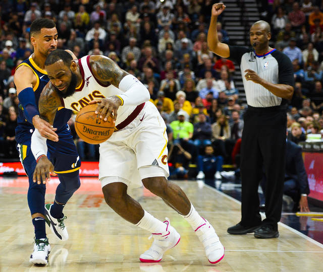 Utah Jazz forward Thabo Sefolosha, left, guards against Cleveland Cavaliers forward LeBron James, right, in the first half of an NBA basketball game Saturday, Dec. 30, 2017, in Salt Lake City. (AP Photo/Alex Goodlett)