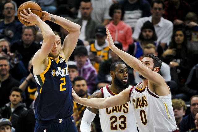 Utah Jazz forward Joe Ingles (2) looks to pass over Cleveland Cavaliers forward Kevin Love (0) in the first half of an NBA basketball game Saturday, Dec. 30, 2017, in Salt Lake City. (AP Photo/Alex Goodlett)