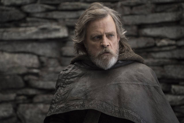 "FILE - This file image released by Lucasfilm shows Mark Hamill as Luke Skywalker in ""Star Wars: The Last Jedi."" On the last day of the calendar year, ""Star Wars: The Last Jedi"" has surpassed ""Beauty and the Beast"" as the top grossing film in North America in 2017.  (John Wilson/Lucasfilm via AP, File)"