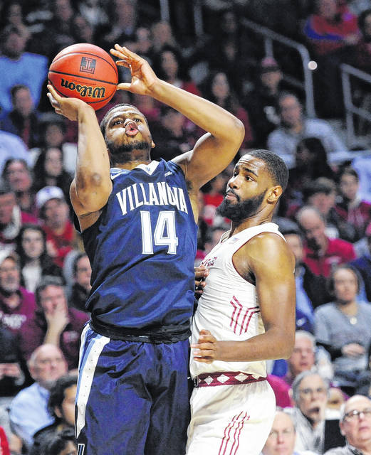 Villanova's Omari Spellman takes a shot against Temple's Damion Moore during Wednesday night's game in Philadelphia.
