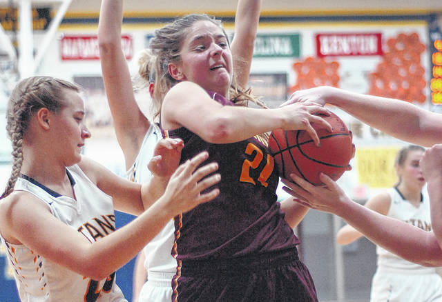 Kalida's Sarah Klausing fights for a rebound against Ottawa-Glandorf's Mackenzie Meyer, left, during Saturday's gameat Ottawa-Glandorf High School.