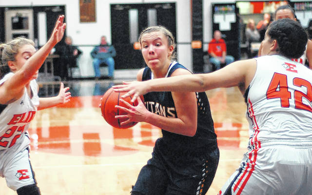 Ottawa-Glandorf's Ashley Schroeder drives to the basket against Elida's Alissa Cuffy (42) and Cienna Kuhn during Thursday night's game at the Elida Fieldhouse.