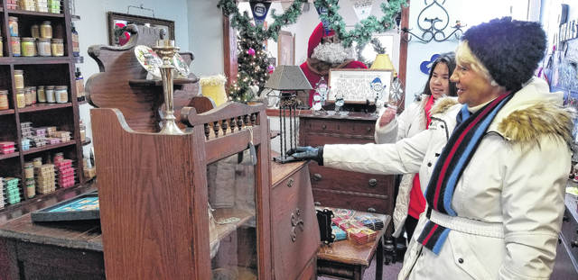 Judie and Erika Harris shop around Roval Antiques in hopes of finding something new.