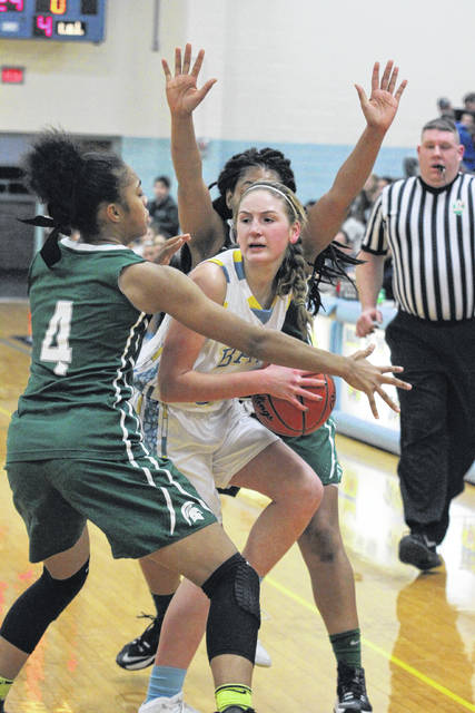 Bath's Madelyn Renner looks for help while being defended by two Toledo Start players during Saturday night's McDonald's Holiday Tournament consolation game at Bath.