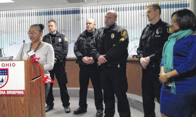 Lima Neighborhood Specialist Autumn Swanson, left, announced Wednesday the formation of a new Community Block Patrol in several Lima neighborhoods. The program will run in conjunction with the Community Oriented Policing program.