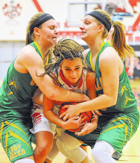 Bluffton's Kayla White, center, gets tied up with Ottoville's Brynlee Hanneman, left, and Haley Hoersten during Saturday's game at Bluffton High School. See more game photos at LimaScores.com.