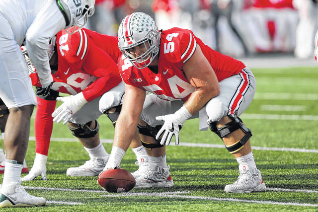 This Nov. 11, 2017, photo shows Ohio State offensive lineman Billy Price playing against Michigan State during an NCAA college football game in Columbus, Ohio.  Price was selected to the AP All-America team announced Monday, Dec. 11, 2017. (AP Photo/Jay LaPrete)