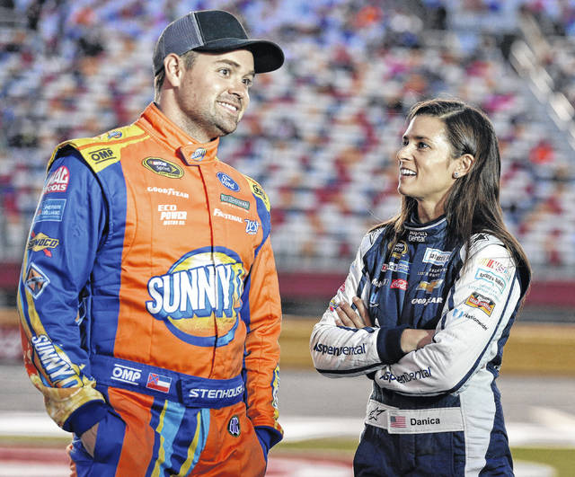 """In this Oct. 6, 2016, file photo, Danica Patrick, right, talks with Ricky Stenhouse Jr, before qualifying for Saturday's NASCAR Sprint Cup series auto race at Charlotte Motor Speedway in Charlotte, N.C. Danica Patrick and Ricky Stenhouse Jr. have ended their nearly five-year relationship. A spokeswoman for Patrick confirmed to The Associated Press on Monday, Dec. 18, 2017, that the race car drivers """"are no longer in a relationship."""""""
