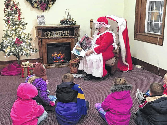 Mrs. Claus reads Christmas stories to children during a past event.