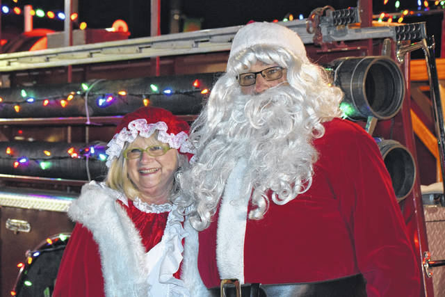 Santa and Mrs. Claus pose after flying in from the North Pole. They were excited to be in Delphos for the Kiwanis Hometown Christmas Friday night.