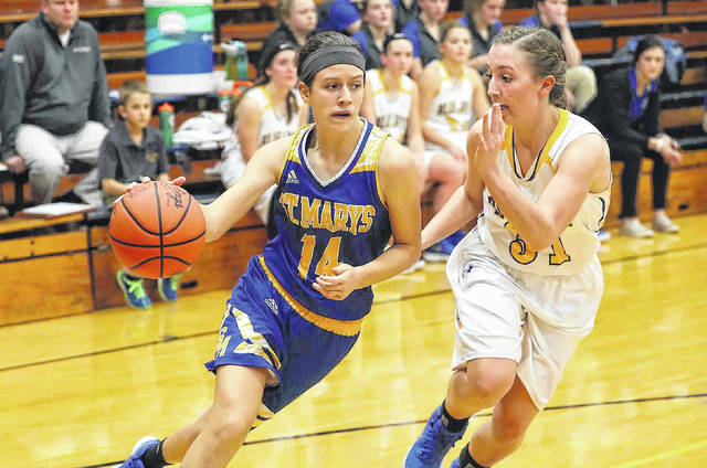 St. Marys' Jill Schmitmeyer drives to the basket against Ellie Csukker of Delphos St. John's during Tuessday night's game in Delphos.