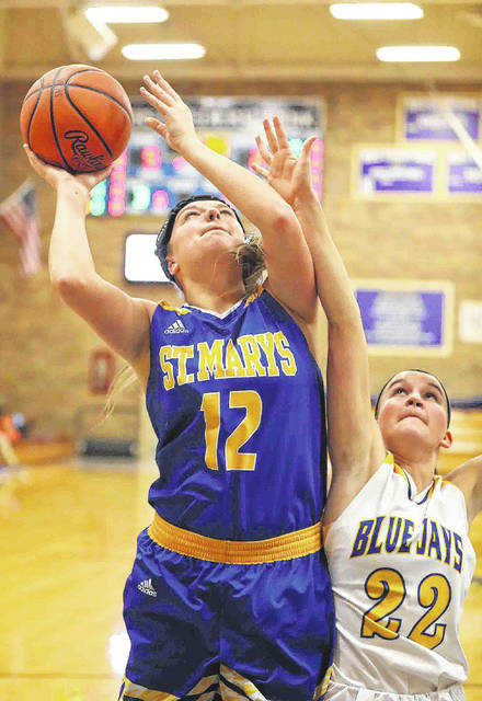 St. Marys' Makenna Mele puts up a shot against Betty Vorst of Delphos St. John's during Tuesday night's game in Delphos.