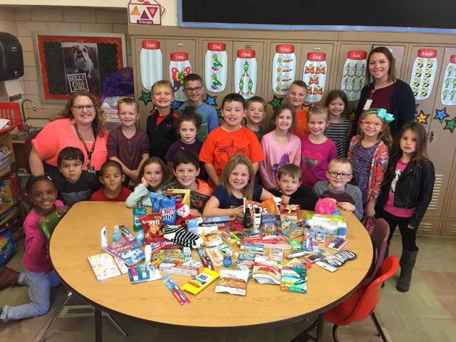 Elida Elementary students in Mrs. Hanefield's first grade class and Mrs. Reese's third grade class collected items to send five Christmas care packages to five soldiers. Submitted.