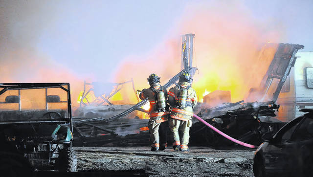 Perry Township Fire Department firefighters try to get a fire on Glenn Avenue under control Tuesday night.