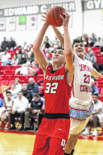 Delphos Jefferson's Alex Rode goes for a shot against Lima Central Catholic's Matthew Cecala during Friday night's game at LCC.